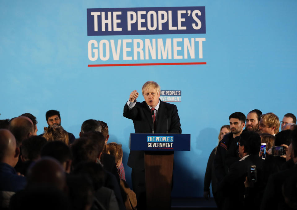 Britain's Prime Minister Boris Johnson speaks at a campaign event at the Queen Elizabeth II Centre in London, Friday, Dec. 13, 2019. Prime Minister Boris Johnson's Conservative Party has won a solid majority of seats in Britain's Parliament — a decisive outcome to a Brexit-dominated election that should allow Johnson to fulfill his plan to take the U.K. out of the European Union next month. (AP Photo/Frank Augstein)