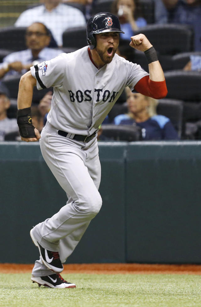 Boston Red Sox's Jacoby Ellsbury celebrates after scoring on a hit by Shane Victorino in the seventh inning in Game 4 of an American League baseball division series, Tuesday, Oct. 8, 2013, in St. Petersburg, Fla. (AP Photo/Mike Carlson)