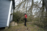 Layla Winbush looks at a fallen tree in front of her damaged home in Lake Charles, La., in the aftermath of Hurricane Laura, Sunday, Aug. 30, 2020. (AP Photo/Gerald Herbert)
