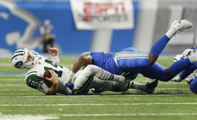 Detroit Lions linebacker Devon Kennard (42) sacks New York Jets quarterback Sam Darnold (14) during the first half of an NFL football game in Detroit, Monday, Sept. 10, 2018. (AP Photo/Rick Osentoski)