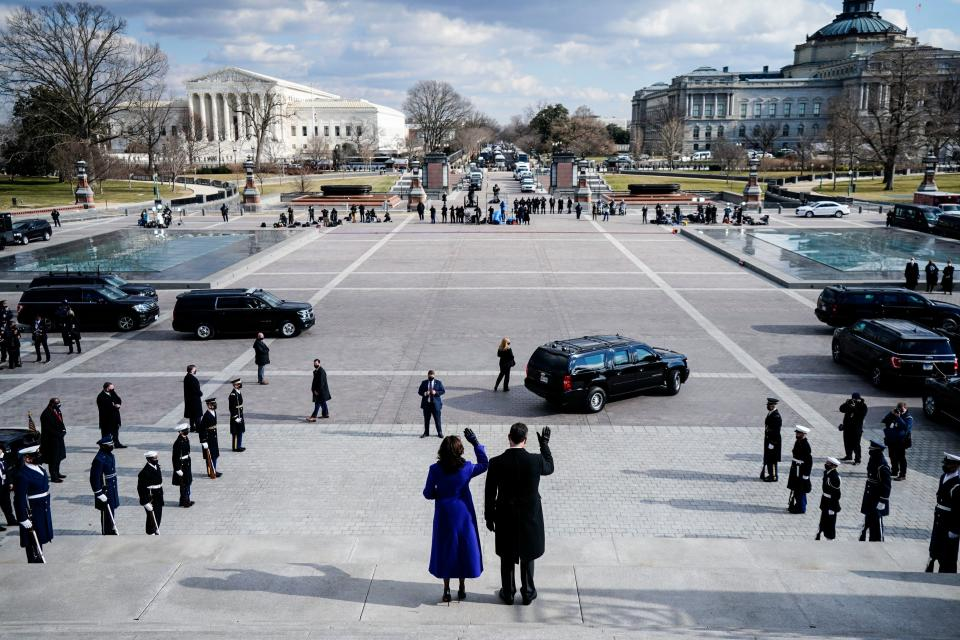 Vice President Kamala Harris and husband Doug Emhoff wave goodbye to former VP Mike Pence and his wife as they leave after the 59th Presidential Inauguration ceremony on January 20, 2021, at the US Capitol in Washington, DC. (Melina Mara/Pool/AFP via Getty Images)