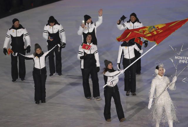 <p>Jelena Vujici carries the flag of Montenegro during the opening ceremony of the 2018 Winter Olympics in Pyeongchang, South Korea, Friday, Feb. 9, 2018. (AP Photo/Michael Sohn) </p>