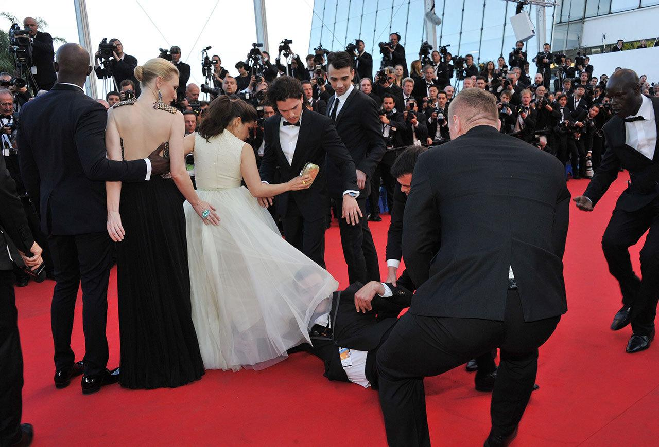 """<p>Notorious nuisance Vitalii Sediuk had already taken on Will Smith, Bradley Cooper, and Leonardo DiCaprio in different """"red carpet attacks"""", but the Ukrainian prankster's attempt to look up America Ferrera's skirt at Cannes in 2014 was a step too far. Many called for the""""journalist"""" to be charged with sexual assault after Ferrera was left visibly shaken by the incident, and he was fired by his TV network. <i>(Credit: Rex)</i><br /></p>"""