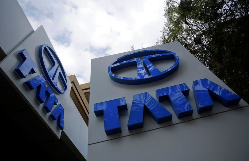 Tata Motors logos are seen at their flagship showroom before the announcement of their Q3 results in Mumbai