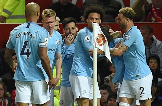 Manchester City celebrate their opening goal against Manchester United (AFP Photo/Oli SCARFF )