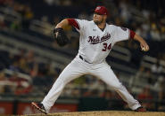 Washington Nationals starting pitcher Jon Lester (34) delivers during a baseball game against the Pittsburgh Pirates, Monday, June 14, 2021, in Washington. (AP Photo/Carolyn Kaster)