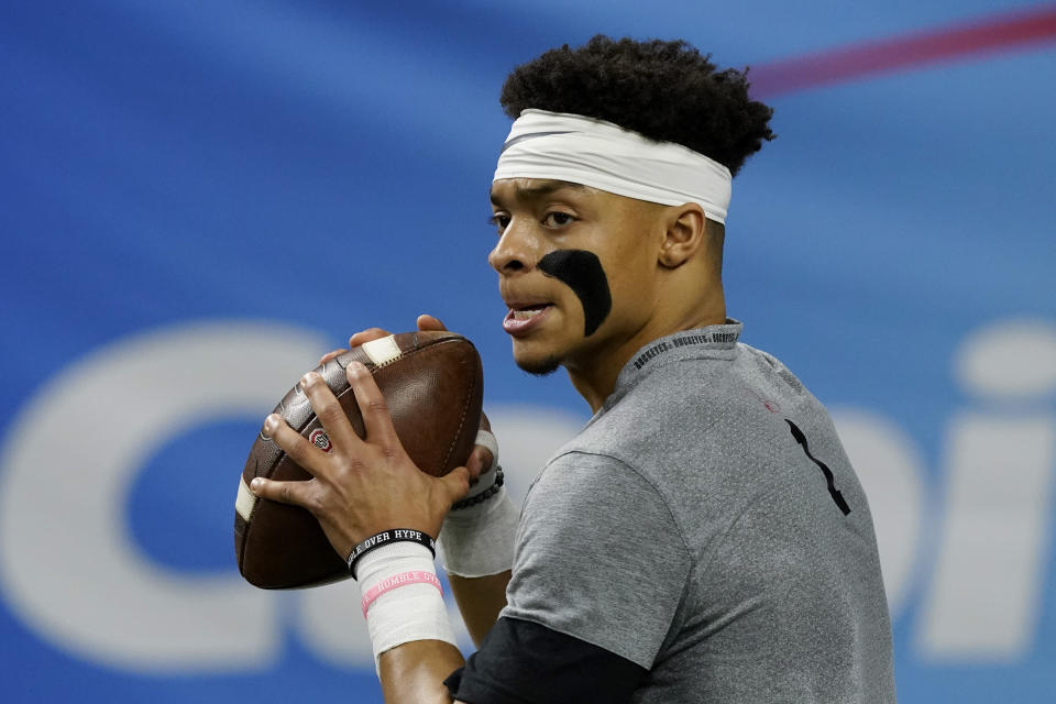 Ohio State quarterback Justin Fields warms up before the Sugar Bowl NCAA college football game against Clemson Friday, Jan. 1, 2021, in New Orleans. (AP Photo/John Bazemore)