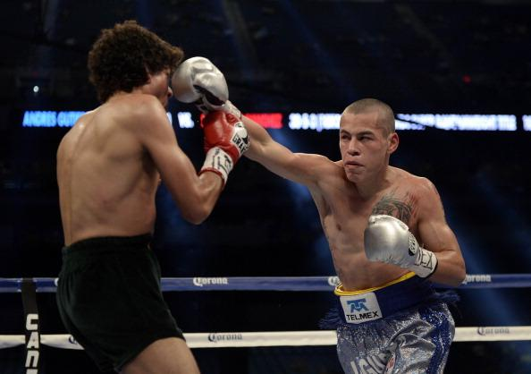 SAN ANTONIO, TX - APRIL 20: Andres Gutierrez lands a punch to the face of Salvador Sanchez en route to Gutierrez's 5th Round TKO victory in the Vacant WBC Silver Super Bantamweight Title Fight, during the Canelo vs. Trout Super Welterwight Title Fight at the Alamodome on April 20, 2013 in San Antonio, Texas. (Photo by Donald Miralle/Golden Boy/Golden Boy via Getty Images)