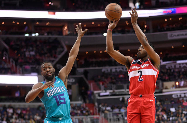 Wizards guard John Wall shoots over Hornets guard Kemba Walker on Saturday. (AP)