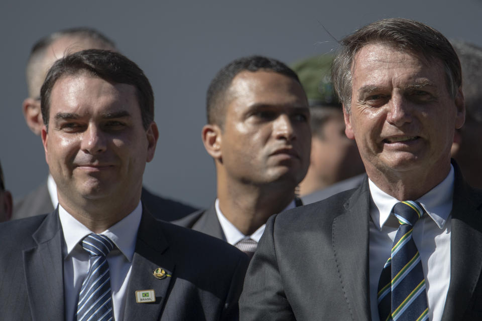 Brazilian President Jair Bolsonaro (R) and his son Flavio attend a ceremony marking the 130th anniversary of the Rio de Janeiro Military School (CMRJ), in Rio de Janeiro, Brazil on May 6, 2019. (Photo by Mauro Pimentel / AFP)        (Photo credit should read MAURO PIMENTEL/AFP via Getty Images)