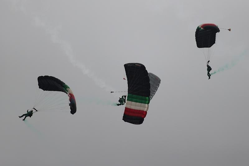 VARIOUS CITIES, MEXICO - SEPTEMBER 16: Parachuters of the Mexican army take part in the Independence Day military parade at Zocalo Square on September 16, 2020 in Various Cities, Mexico. This year El Zocalo remains closed for general public due to coronavirus restrictions. Every September 16 Mexico celebrates the beginning of the revolution uprising of 1810. (Photo by Hector Vivas/Getty Images)