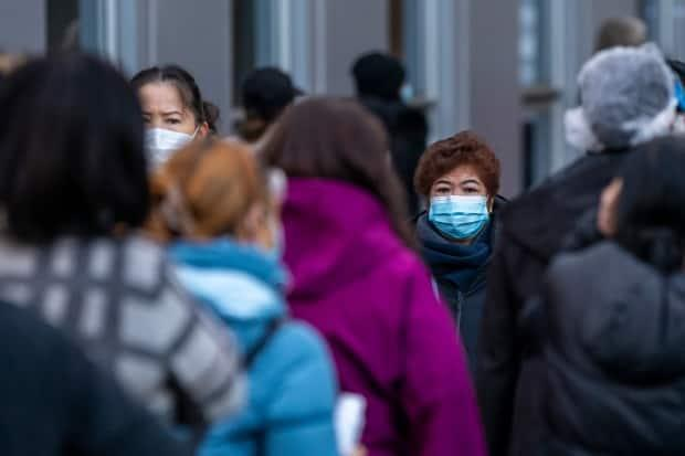 People wait in line for their COVID-19 vaccine in Vancouver on Dec. 22, 2020. (Ben Nelms/CBC - image credit)