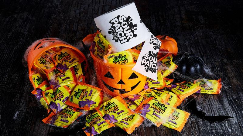 Jack O'lantern bucket of Sour Patch Kids candy and a Sour Patch branded roll of toilet paper
