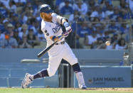 Los Angeles Dodgers' Justin Turner hits a three-run home run against the San Diego Padres in the seventh inning in a baseball game Sunday, Sept. 12, 2021, in Los Angeles, Calif. (AP Photo/John McCoy)