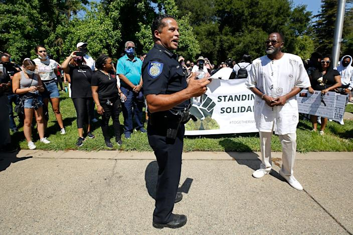 """Hahn speaks at a rally in honor of George Floyd on June 3, 2020. <p class=""""copyright""""><a href=""""https://newsroom.ap.org/detail/CaliforniaBlackPoliceChiefsReform/e490928dd24d42a5ba13a31b2fb6face/photo?Query=daniel%20AND%20hahn&mediaType=photo&sortBy=arrivaldatetime:desc&dateRange=Anytime&totalCount=76&currentItemNo=1"""" rel=""""nofollow noopener"""" target=""""_blank"""" data-ylk=""""slk:Rich Pedroncelli/AP"""" class=""""link rapid-noclick-resp"""">Rich Pedroncelli/AP</a></p>"""