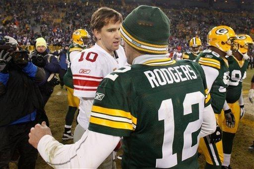 Green Bay Packers quarterback Aaron Rodgers, right, talks with New York Giants quarterback Eli Manning, left, after an NFL divisional playoff football game Sunday, Jan. 15, 2012, in Green Bay, Wis. Giants won 37-20. (AP Photo/Jeffrey Phelps)