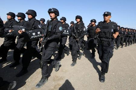 Chinese soldiers participate in an anti-terror drill in Hami, Xinjiang Uighur Autonomous Region