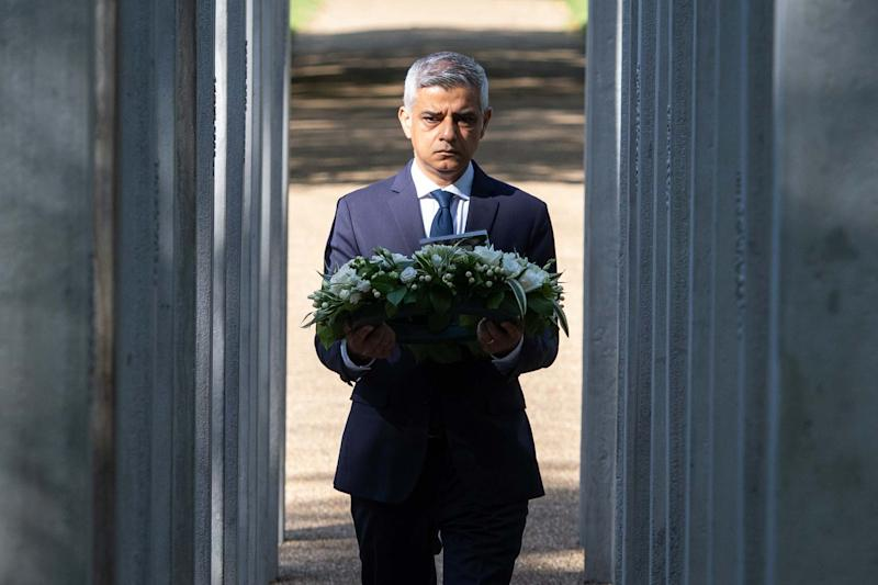 Sadiq Khan approaches to lay a wreath at the London Bombing Memorial in Hyde Park, London (PA)