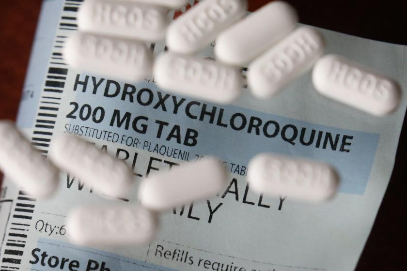 FILE - This Monday, April 6, 2020, file photo shows an arrangement of Hydroxychloroquine pills in Las Vegas. At least 13 states have obtained a total of more than 10 million doses of malaria drugs to treat COVID-19 patients despite warnings from doctors that more tests are needed before the medications that President Trump once fiercely promoted should be used to help people with the coronavirus. (AP Photo/John Locher,File)