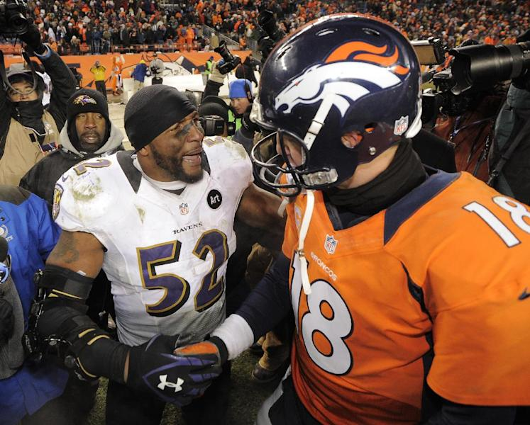 Baltimore Ravens inside linebacker Ray Lewis shakes hands Denver Broncos quarterback Peyton Manning (18) after the Ravens won 38-35 in overtime of an AFC divisional playoff NFL football game, Saturday, Jan. 12, 2013, in Denver. (AP Photo/Jack Dempsey)