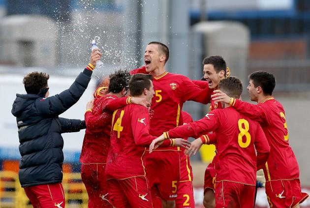 Montenegro players celebrate after the game