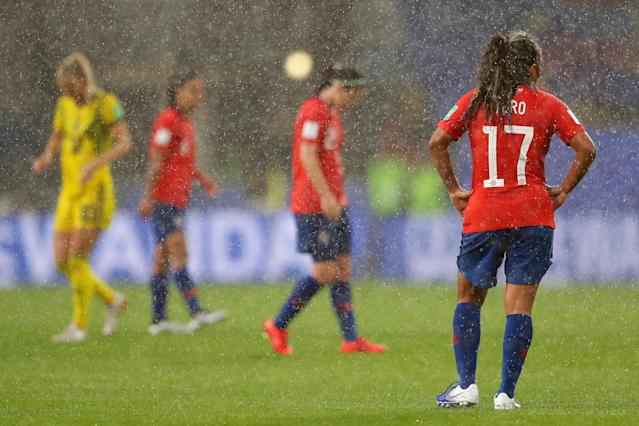 """Severe weather, including <a class=""""link rapid-noclick-resp"""" href=""""/nhl/teams/tampa-bay/"""" data-ylk=""""slk:lightning"""">lightning</a> strikes, suspended Tuesday's match between Chile and Sweden. (Photo by Richard Heathcote/Getty Images)"""