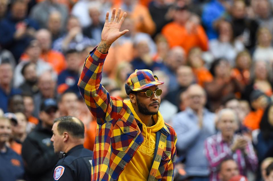 SYRACUSE, NY - NOVEMBER 06:  Syracuse Orange basketball alum Carmelo Anthony waves to the crowd during the first half of the game between the Virginia Cavaliers and the Syracuse Orange at the Carrier Dome on November 6, 2019 in Syracuse, New York. Virginia defeated Syracuse 48-34. (Photo by Rich Barnes/Getty Images)