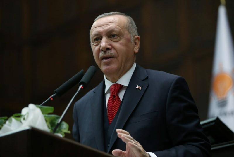 Turkish President Erdogan addresses lawmakers from his ruling AK Party during a meeting at the parliament in Ankara