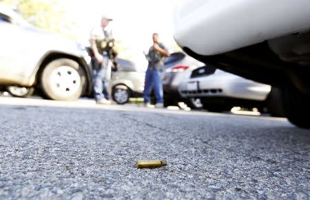 A spent cartridge lies on the ground as police officers secure the area after at least one person opened fire at a social services agency in San Bernardino, California December 2, 2015. REUTERS/Mario Anzuoni