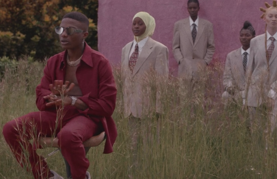 <p>Nigerian singer Wizkid introduces the track 'Brown Skin Girl,' backed by a pink wall and suited women.</p>