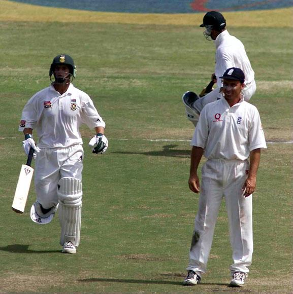 30 Dec1999:  Gary Kirsten and Mark Boucher of South Africa run past England captain Nasser Hussain during the third test match at Kingsmeade in Durban, South Africa. Mandatory Credit: Laurence Griffiths/ALLSPORT