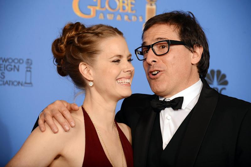 """Amy Adams, left, and David O. Russell, winners of the award for best motion picture - comedy or musical for """"American Hustle"""" pose in the press room at the 71st annual Golden Globe Awards at the Beverly Hilton Hotel on Sunday, Jan. 12, 2014, in Beverly Hills, Calif. (Photo by Jordan Strauss/Invision/AP)"""