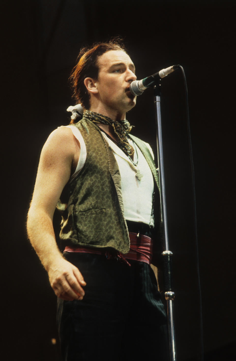 Bono of U2 performs on stage on The Joshua Tree Tour, Feyenoord Stadion, De Kuip, Rotterdam, Netherlands, 10th July 1987. (Photo by Rob Verhorst/Redferns)