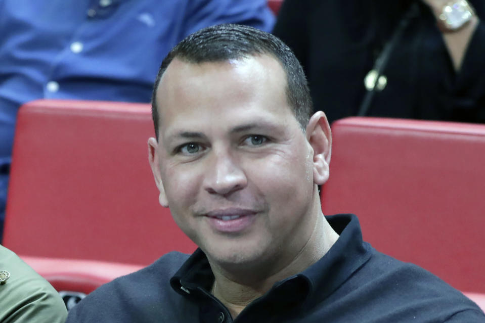 FILE - Alex Rodriguez sits court side during the first half of an NBA basketball game between the Miami Heat and Los Angeles Lakers in Miami, in this Friday, Dec. 13, 2019, file photo. Minnesota Timberwolves owner Glen Taylor has reached agreement on his $1.5 billion sale of the club. He's selling to e-commerce mogul Marc Lore and former baseball star Alex Rodriguez. The news was confirmed by a person with knowledge of the negotiation speaking on condition of anonymity because league approval was still pending. (AP Photo/Lynne Sladky, File)