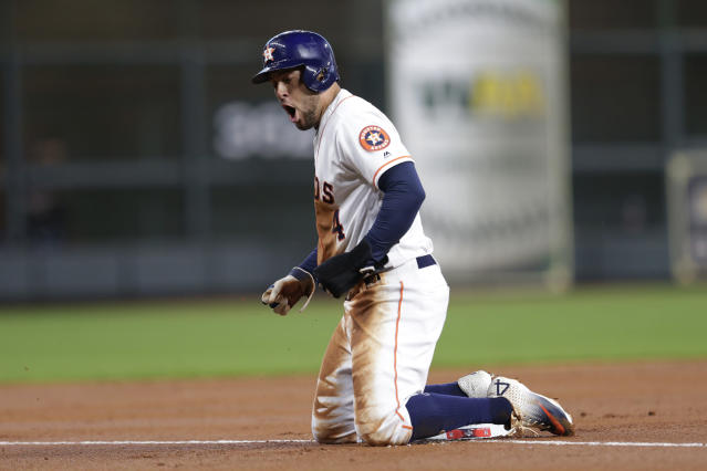 Houston Astros center fielder George Springer reacts after advancing to third base against the Tampa Bay Rays during the first inning of Game 5 of a baseball American League Division Series in Houston, Thursday, Oct. 10, 2019. (AP Photo/Michael Wyke)