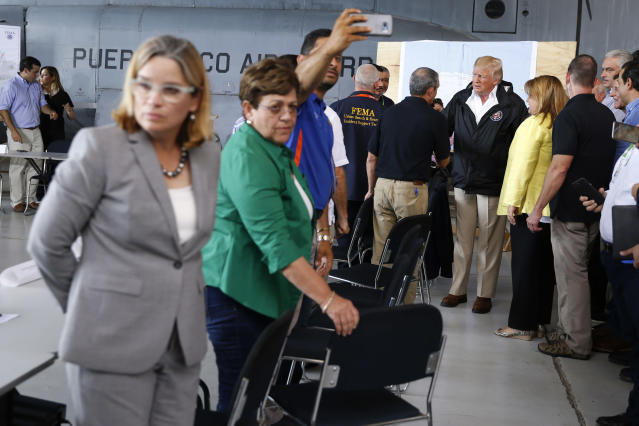 San Juan Mayor Carmen Yulin Cruz (far L) waits to greet U.S. President Donald Trump before a briefing to survey hurricane damage at Muniz Air National Guard Base in Carolina, Puerto Rico, Oct. 3, 2017. (Photo: Jonathan Ernst/Reuters)