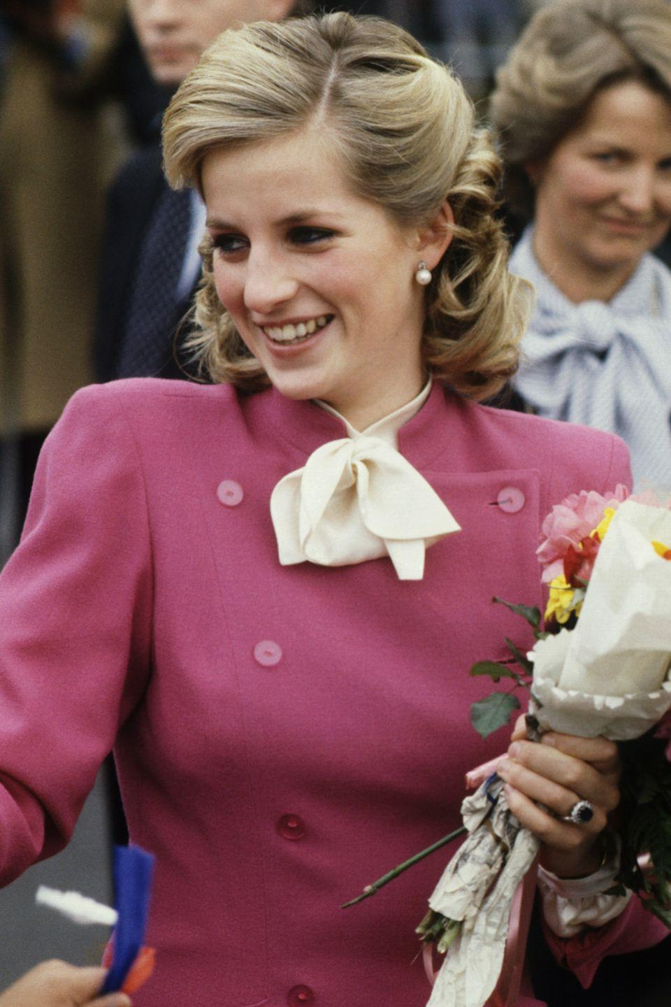 <p>With her longer hair, Diana tried bigger curls pinned back while visiting the Deaf, Blind and Rubella Council Family Centre. </p>