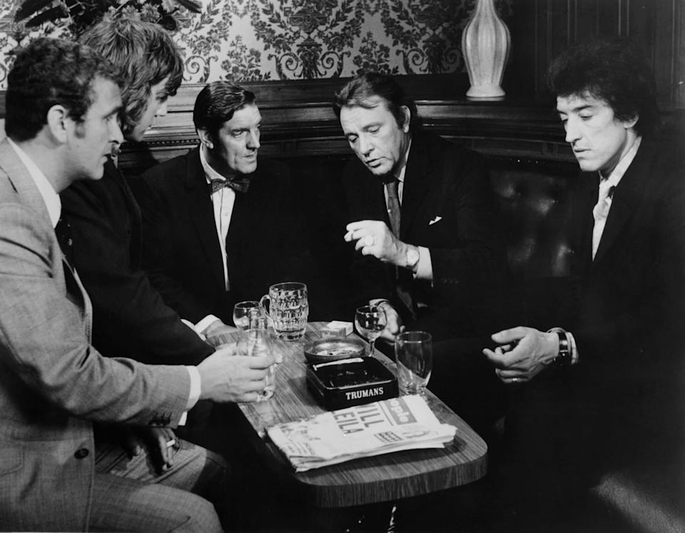 Tony Selby, left, with other henchmen planning a heist with Richard Burton, second right, in Villain (1971) - Metro-Goldwyn-Mayer/Getty Images