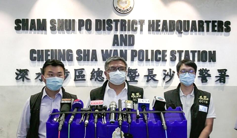 Police brief the media about a 16-year-old schoolboy and his parents after their arrest on suspicion of sending a threatening letter claiming that home-made bombs targeting officers had been planted across the city. Photo: Hong Kong Police