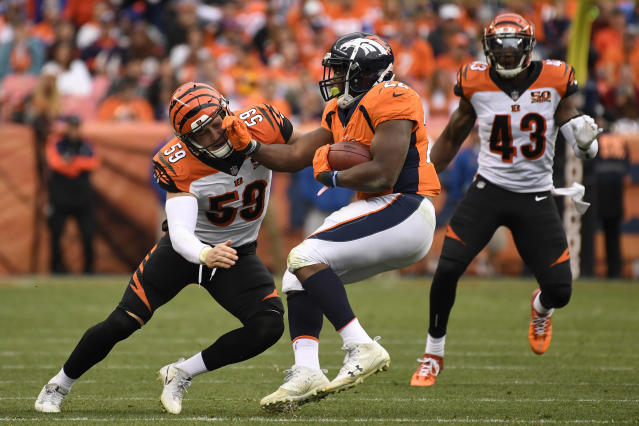 <p>C.J. Anderson (22) of the Denver Broncos pushes aside Nick Vigil (59) of the Cincinnati Bengals during the second quarter. The Denver Broncos hosted the Cincinnati Bengals at Sports Authority Field at Mile High in Denver, Colorado on Sunday, November 19, 2017. (Photo by Joe Amon/The Denver Post) </p>
