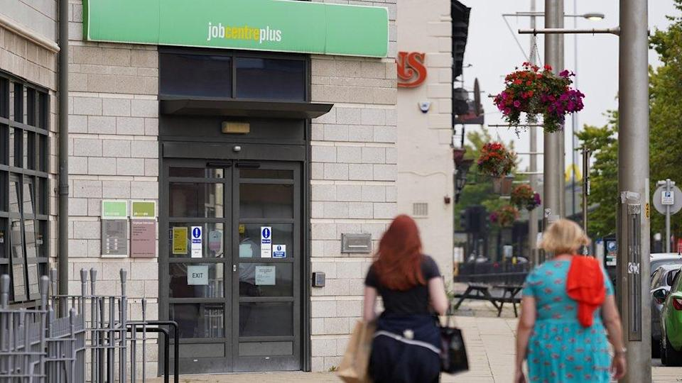 Two women walk past a job centre