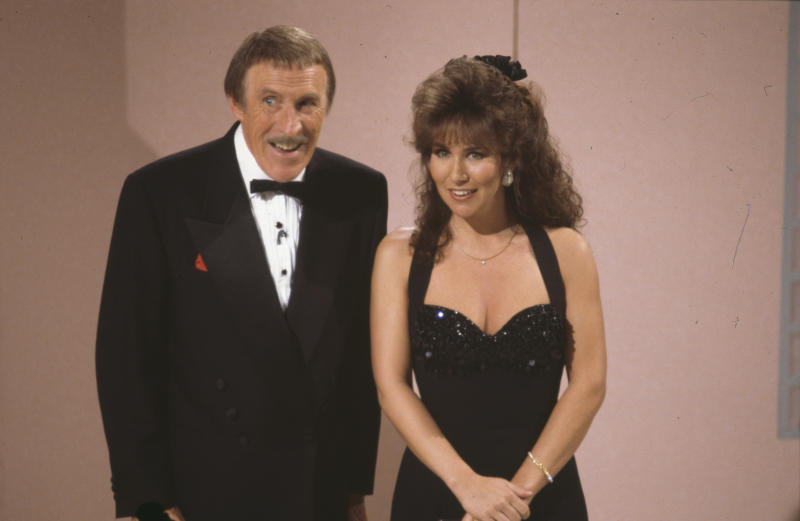 Entertainer Bruce Forsyth and model Linda Lusardi presenting the BBC television show 'Bruce Foryth's Easter Show', February 26th 1991. (Photo by Don Smith/Radio Times/Getty Images)