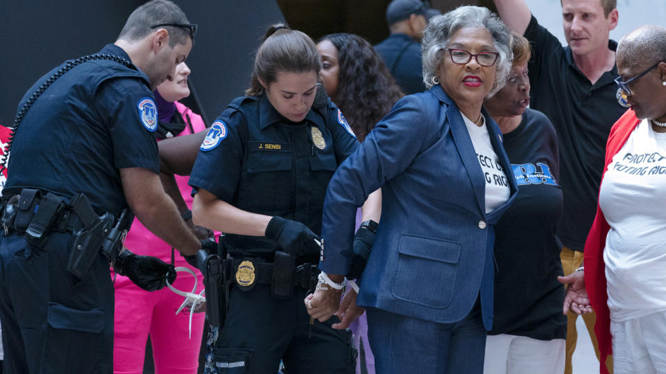 Rep. Joyce Beatty, D-Ohio, chairwoman of the Congressional Black Caucus is taken into custody by U.S. Capitol Police officers in the Hart Senate Office Building, after a demonstration supporting the voting rights, on Capitol Hill, Thursday, July 15, 2021, in Washington. (AP Photo/Jose Luis Magana)