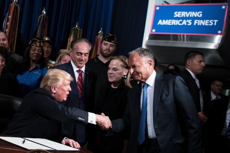 US President Donald Trump shakes Ike Perlmutter, CEO of Marvel Entertainment, hand before signing an executive order at the US Department of Veterans Affairs April 27, 2017 in Washington, DC. / AFP PHOTO / Brendan Smialowski (Photo credit should read BRENDAN SMIALOWSKI/AFP/Getty Images)