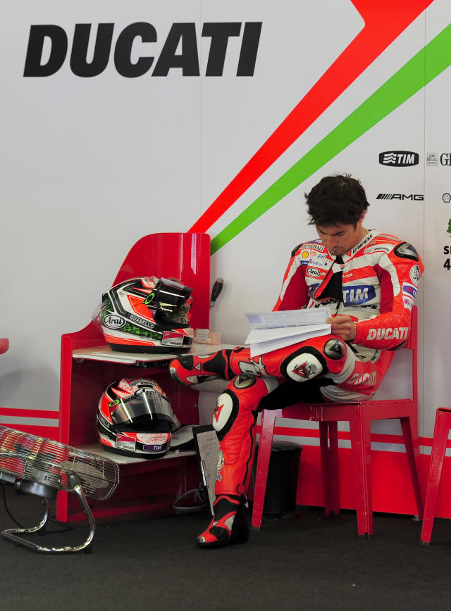 Ducati Team's US Nicky Hayden reads a telemetry report during a Moto GP training session at the Catalunya racetrack in Montmelo, near Barcelona, on June 4, 2012. AFP PHOTO / JOSEP LAGOJOSEP LAGO/AFP/GettyImages