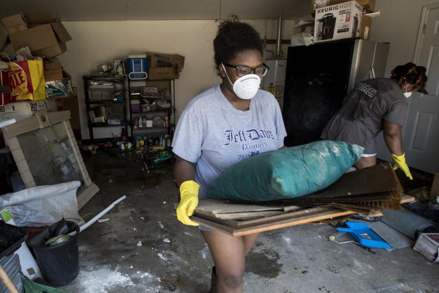 <p>Menion Brock and Michelle Green clean up their home, damaged by floodwaters of Tropical Storm Harvey, in the Parkway Forest subdivision of Houston, Thursday, Aug. 31, 2017. (Photo: Brett Coomer/Houston Chronicle via AP) </p>