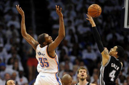 Oklahoma City Thunder forward Kevin Durant (35) loses the ball during a shot attempt against San Antonio Spurs guard Danny Green (4) during the fourth quarter in game six of the Western Conference Finals of the 2014 NBA Playoffs at Chesapeake Energy Arena. Mandatory Credit: Mark D. Smith-USA TODAY Sports