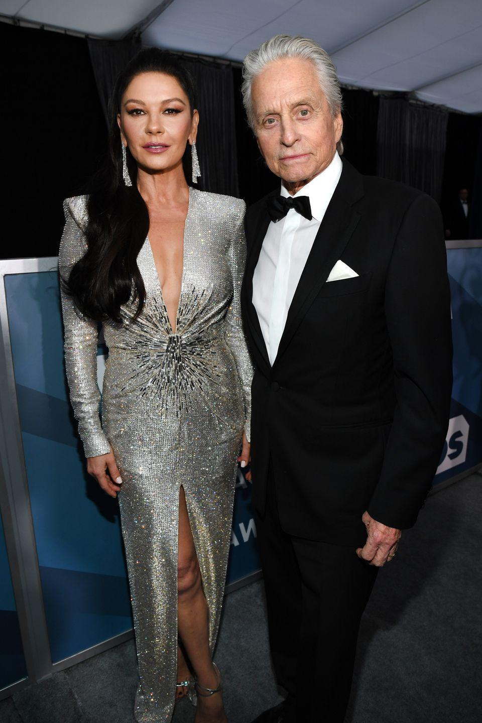 "<p>Over 350 guests attended Michael Douglas and Catherine Zeta-Jones' wedding held at the Plaza Hotel in New York City, which reportedly cost <a href=""https://www.cbsnews.com/pictures/most-expensive-weddings-of-all-time/4/#:~:text=The%20wedding%20of%20the%2021st,.com%20and%20People.com."" rel=""nofollow noopener"" target=""_blank"" data-ylk=""slk:around $1.5 million."" class=""link rapid-noclick-resp"">around $1.5 million.</a> The pair casually had performances from Jimmy Buffett and Art Garfunkel during the ceremony, because, duh! </p>"