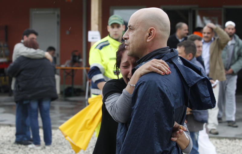A woman cries following an earthquake in Sant'Agostino, Sunday, May 20. 2012. One of the worst quakes to hit northeast Italy in hundreds of years rattled the region around Bologna early Sunday, killing at least four people, collapsing factories and sending residents running out into the streets, emergency services said. (AP Photo/Luca Bruno)