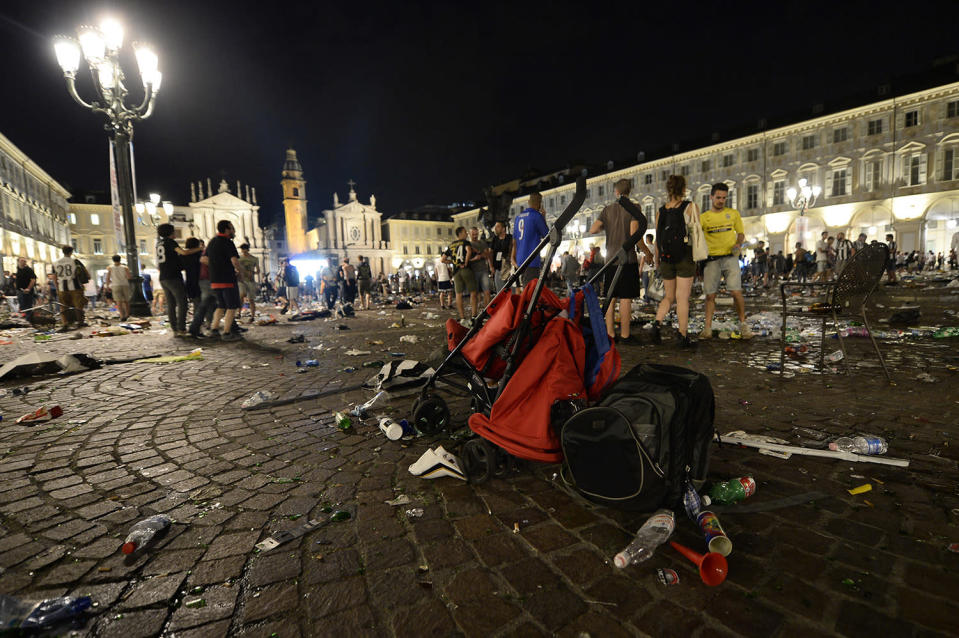 <p>A stroller is abandoned at Piazza San Carlo after a panic movement in the fanzone where thousands of Juventus fans were watching the UEFA Champions League Final football match between Juventus and Real Madrid on a giant screen, on June 3, 2017 in Turin. (Massimo Pinca/AFP/Getty Images) </p>